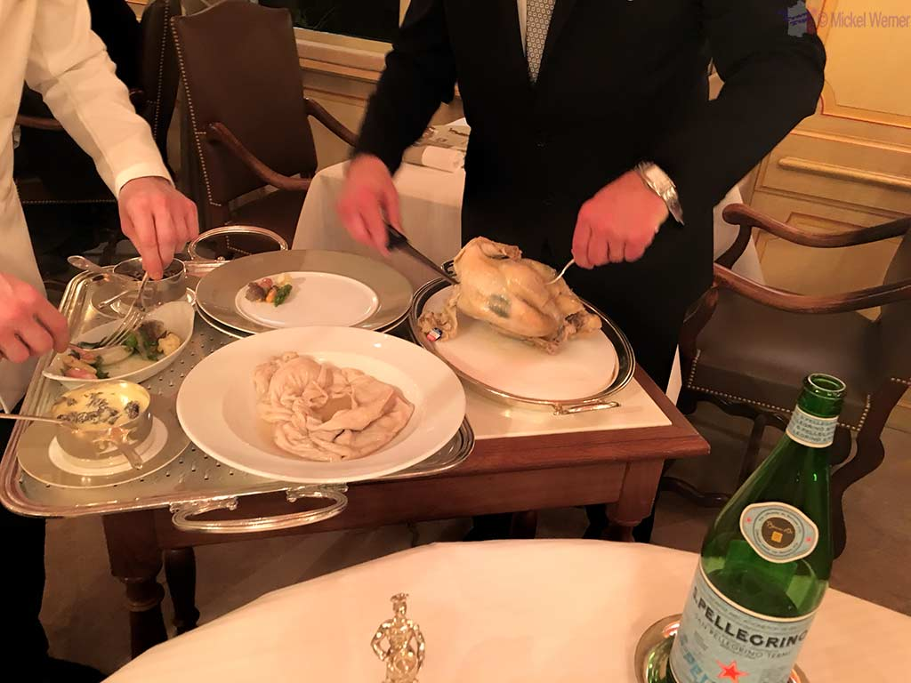 Chicken cooked in a bladder prepared at your table at Paul Bocuse's restaurant in Lyon